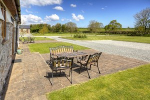 Elidir Holiday Cottage Front Patio with Views Across Lawns